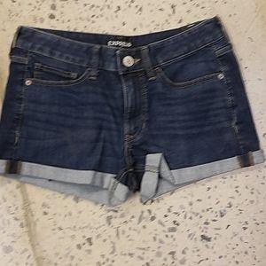 Express low-rise shorty roll cuff denim shorts